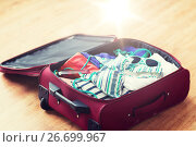 Купить «close up of travel bag with beach clothes», фото № 26699967, снято 9 февраля 2016 г. (c) Syda Productions / Фотобанк Лори