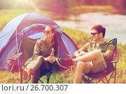 Купить «happy couple drinking beer at campsite tent», фото № 26700307, снято 27 мая 2016 г. (c) Syda Productions / Фотобанк Лори