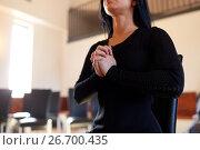 Купить «close up of sad woman praying god in church», фото № 26700435, снято 20 марта 2017 г. (c) Syda Productions / Фотобанк Лори