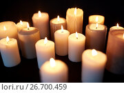 Купить «candles burning in darkness over black background», фото № 26700459, снято 20 марта 2017 г. (c) Syda Productions / Фотобанк Лори