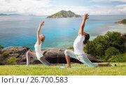 Купить «couple making yoga in low lunge pose outdoors», фото № 26700583, снято 6 августа 2014 г. (c) Syda Productions / Фотобанк Лори