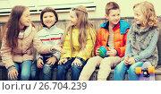 Купить «children communicate sitting on bench in yard», фото № 26704239, снято 25 марта 2016 г. (c) Татьяна Яцевич / Фотобанк Лори