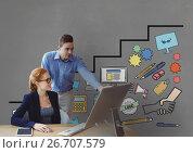 Купить «Business people at a desk looking at a computer against grey background with graphics», фото № 26707579, снято 19 февраля 2019 г. (c) Wavebreak Media / Фотобанк Лори