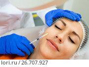 Купить «Female doctor doing beauty injection to young woman client», фото № 26707927, снято 17 августа 2018 г. (c) Яков Филимонов / Фотобанк Лори