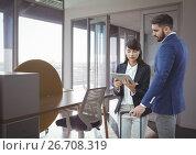 Купить «Business people looking at a tablet», фото № 26708319, снято 30 мая 2020 г. (c) Wavebreak Media / Фотобанк Лори