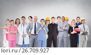Group of people with different professions standing in front of blank grey background. Стоковое фото, агентство Wavebreak Media / Фотобанк Лори