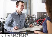 Купить «employee helping adult guy to select bike at rental agency», фото № 26710987, снято 16 октября 2018 г. (c) Яков Филимонов / Фотобанк Лори