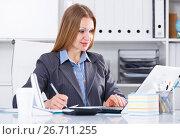Купить «Smiling woman working in office», фото № 26711255, снято 20 апреля 2017 г. (c) Яков Филимонов / Фотобанк Лори