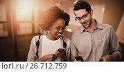 Купить «Composite image of 2 smiling peoples are using mobile phone», фото № 26712759, снято 19 октября 2018 г. (c) Wavebreak Media / Фотобанк Лори