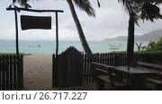 Купить «Seychelles, a cafe on the beach in the rain. 2013», видеоролик № 26717227, снято 31 октября 2013 г. (c) Mikhail Starodubov / Фотобанк Лори
