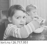 Купить «Two children eating yogurt», фото № 26717951, снято 30 мая 2020 г. (c) Яков Филимонов / Фотобанк Лори