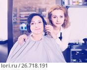 Купить «Woman is satisfied with work of haircutter», фото № 26718191, снято 7 марта 2017 г. (c) Яков Филимонов / Фотобанк Лори