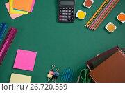 Купить «Various school supplies on green background», фото № 26720559, снято 5 апреля 2017 г. (c) Wavebreak Media / Фотобанк Лори
