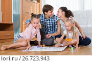 Купить «Family playing at board game», фото № 26723943, снято 18 августа 2018 г. (c) Яков Филимонов / Фотобанк Лори