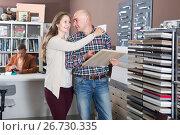 Купить «Married couple decides to buy kitchen furniture», фото № 26730335, снято 4 апреля 2017 г. (c) Яков Филимонов / Фотобанк Лори