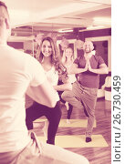 Купить «Coach showing to learners yoga posture», фото № 26730459, снято 8 июля 2020 г. (c) Яков Филимонов / Фотобанк Лори