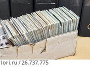 Купить «Много трудовых книжек в старой коробке на фоне деловых папок. Кадровое делопроизводство», фото № 26737775, снято 3 августа 2017 г. (c) Наталья Осипова / Фотобанк Лори