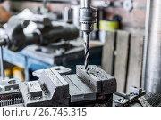 Купить «Drilling machine. The drill bit is installed in the drill chuck.», фото № 26745315, снято 15 июня 2017 г. (c) Андрей Радченко / Фотобанк Лори