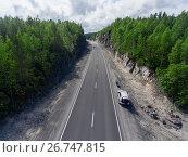 Купить «Мотоцикл и автомобиль на обочине загородной трассы. Вид сверху», фото № 26747815, снято 14 июля 2017 г. (c) Кекяляйнен Андрей / Фотобанк Лори