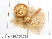 Купить «Pine nuts peeled in a spoon on a white wooden background», фото № 26750783, снято 5 августа 2017 г. (c) Марина Володько / Фотобанк Лори
