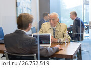 Купить «Financial advisor consulting senior client with his investment strategy.», фото № 26752519, снято 30 мая 2020 г. (c) Matej Kastelic / Фотобанк Лори
