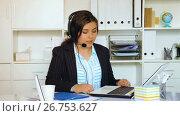 Купить «Young female worker productively operating at call-centre», видеоролик № 26753627, снято 19 июня 2017 г. (c) Яков Филимонов / Фотобанк Лори