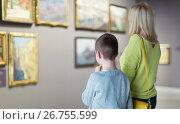 Купить «Mother and son regarding paintings in halls of museum», фото № 26755599, снято 18 марта 2017 г. (c) Яков Филимонов / Фотобанк Лори