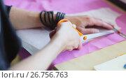 Купить «fashion designer hands cutting cloth with scissors», видеоролик № 26756763, снято 20 августа 2019 г. (c) Syda Productions / Фотобанк Лори
