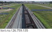 Купить «Aerial view UHD 4K of freight train with wagons and standing train with coal», видеоролик № 26759135, снято 21 июля 2017 г. (c) Сергей Тимофеев / Фотобанк Лори