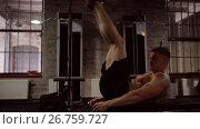 Купить «young man doing abdominal exercise in gym», видеоролик № 26759727, снято 5 июля 2017 г. (c) Syda Productions / Фотобанк Лори