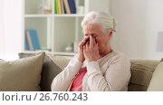 Купить «senior woman with glasses having vision problem», видеоролик № 26760243, снято 25 июня 2017 г. (c) Syda Productions / Фотобанк Лори