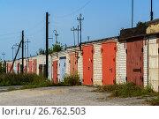 Купить «Brick garages with metal gates of garage cooperative», фото № 26762503, снято 14 августа 2017 г. (c) Володина Ольга / Фотобанк Лори