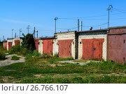 Купить «Brick garages with red metal gates of garage cooperative», фото № 26766107, снято 14 августа 2017 г. (c) Володина Ольга / Фотобанк Лори