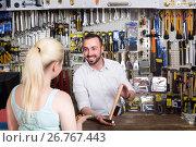 Купить «Seller and customer in household store», фото № 26767443, снято 27 января 2020 г. (c) Яков Филимонов / Фотобанк Лори