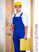 Купить «Professional serviceman with tools», фото № 26773595, снято 17 августа 2018 г. (c) Яков Филимонов / Фотобанк Лори
