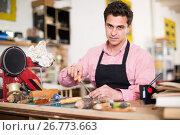 Купить «Joiner working in workshop», фото № 26773663, снято 8 апреля 2017 г. (c) Яков Филимонов / Фотобанк Лори