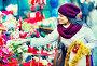 Girl buying floral compositions at Christmas fair, фото № 26773783, снято 22 августа 2017 г. (c) Яков Филимонов / Фотобанк Лори