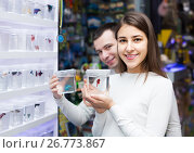 Купить «Portrait of couple selecting aquarium fish in display», фото № 26773867, снято 21 февраля 2019 г. (c) Яков Филимонов / Фотобанк Лори