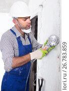 Купить «Male builder renovating with circular saw in gloves», фото № 26783859, снято 18 мая 2017 г. (c) Яков Филимонов / Фотобанк Лори