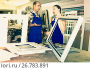 Купить «Foreman explaining plastic windows assembly process to young female worker», фото № 26783891, снято 19 июля 2017 г. (c) Яков Филимонов / Фотобанк Лори