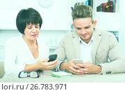 Купить «Mother and son with smartphones», фото № 26783971, снято 8 июля 2020 г. (c) Яков Филимонов / Фотобанк Лори
