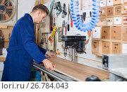 Young guy using machine to process plank. Стоковое фото, фотограф Яков Филимонов / Фотобанк Лори