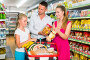 Positive family with teen daughter and purchases in shopping, фото № 26785275, снято 11 июля 2017 г. (c) Яков Филимонов / Фотобанк Лори