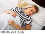 Girl sleeping with striped pygamas. Стоковое фото, фотограф Яков Филимонов / Фотобанк Лори