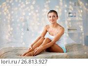 Купить «beautiful woman with bare legs on bed at home», фото № 26813927, снято 9 апреля 2017 г. (c) Syda Productions / Фотобанк Лори