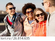 Купить «happy teenage friends in shades talking on street», фото № 26814635, снято 19 марта 2015 г. (c) Syda Productions / Фотобанк Лори