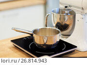 Купить «electric mixer and pot on stove at kitchen», фото № 26814943, снято 8 мая 2017 г. (c) Syda Productions / Фотобанк Лори