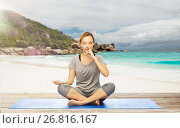 Купить «woman doing yoga breathing exercise on beach», фото № 26816167, снято 13 ноября 2015 г. (c) Syda Productions / Фотобанк Лори