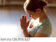 Купить «close up of woman meditating at yoga studio», фото № 26816627, снято 5 марта 2017 г. (c) Syda Productions / Фотобанк Лори