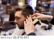 Купить «man and barber hands with trimmer cutting hair», фото № 26816651, снято 6 апреля 2017 г. (c) Syda Productions / Фотобанк Лори